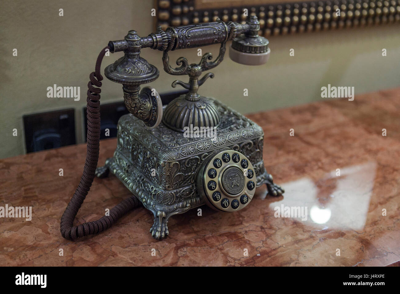 ornate, decorative telephone but also functional and operational Stock Photo