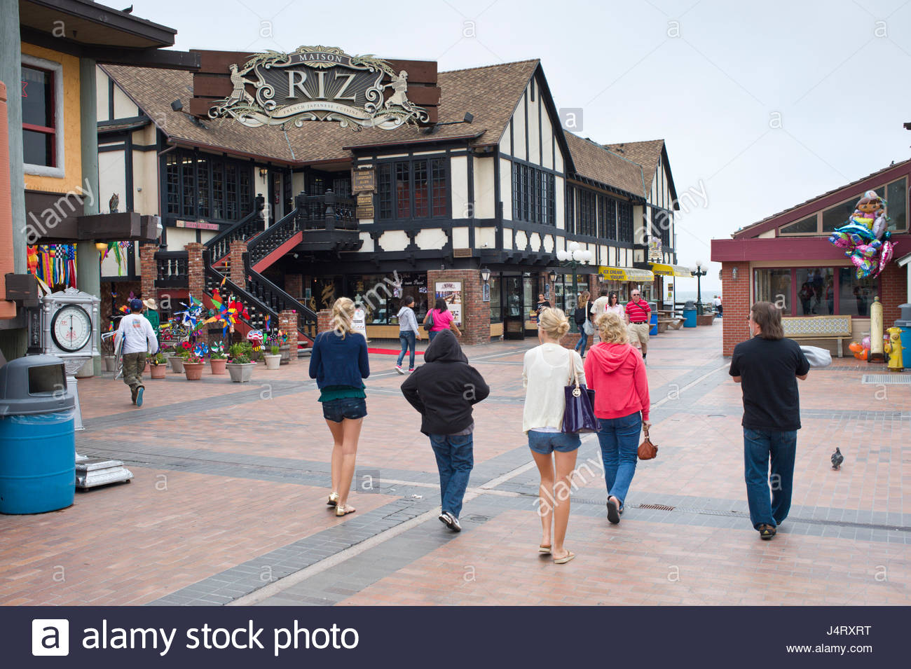 People Walking Past Shops And Restaurants On Redondo Beach