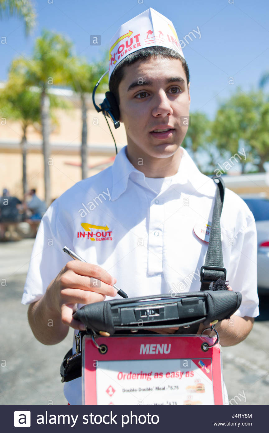 Young man taking lunch order for hamburgers at the IN-N-OUT