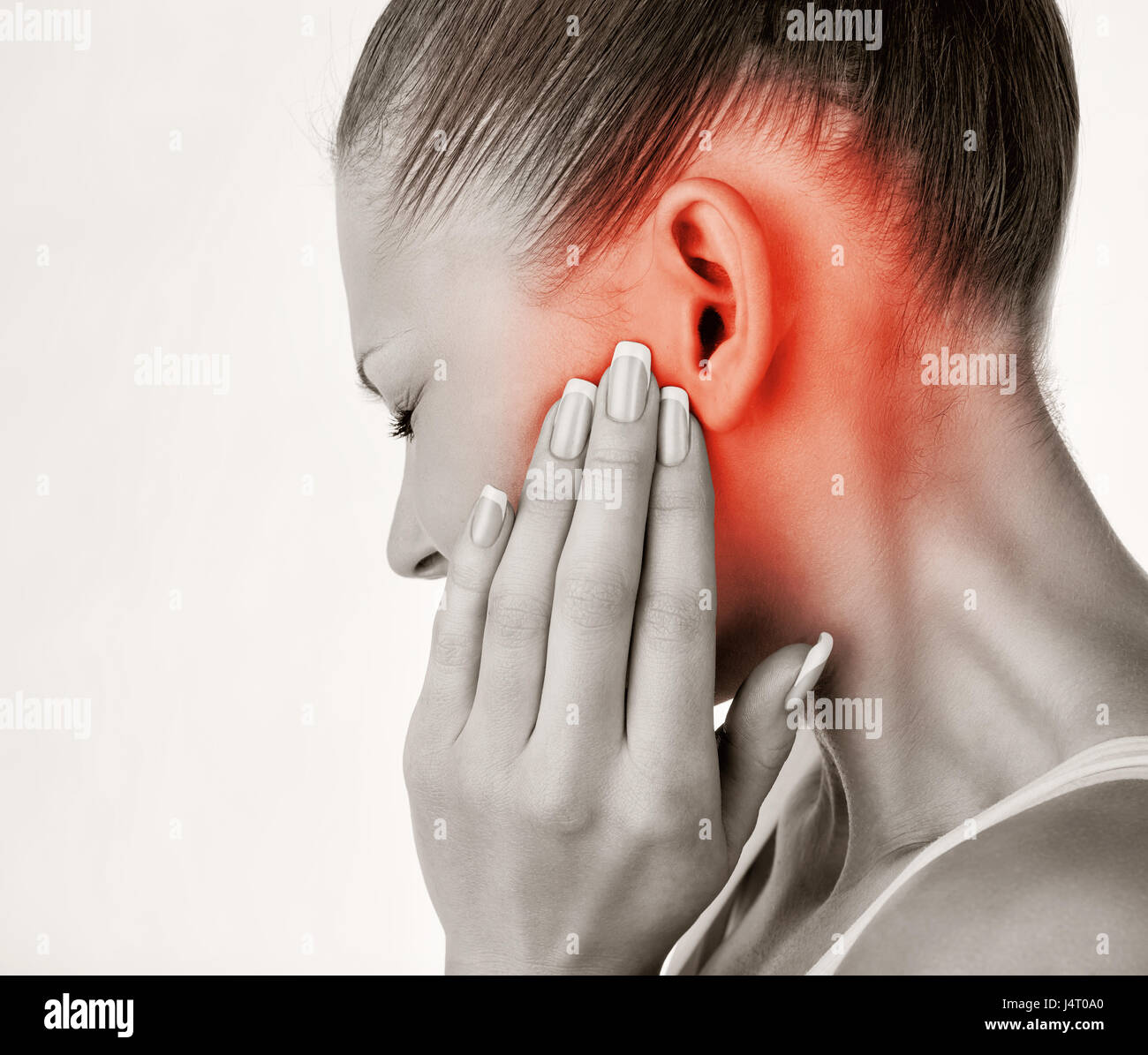 Young woman with ear pain, holding hand on his head. Isolate on white background - Stock Image