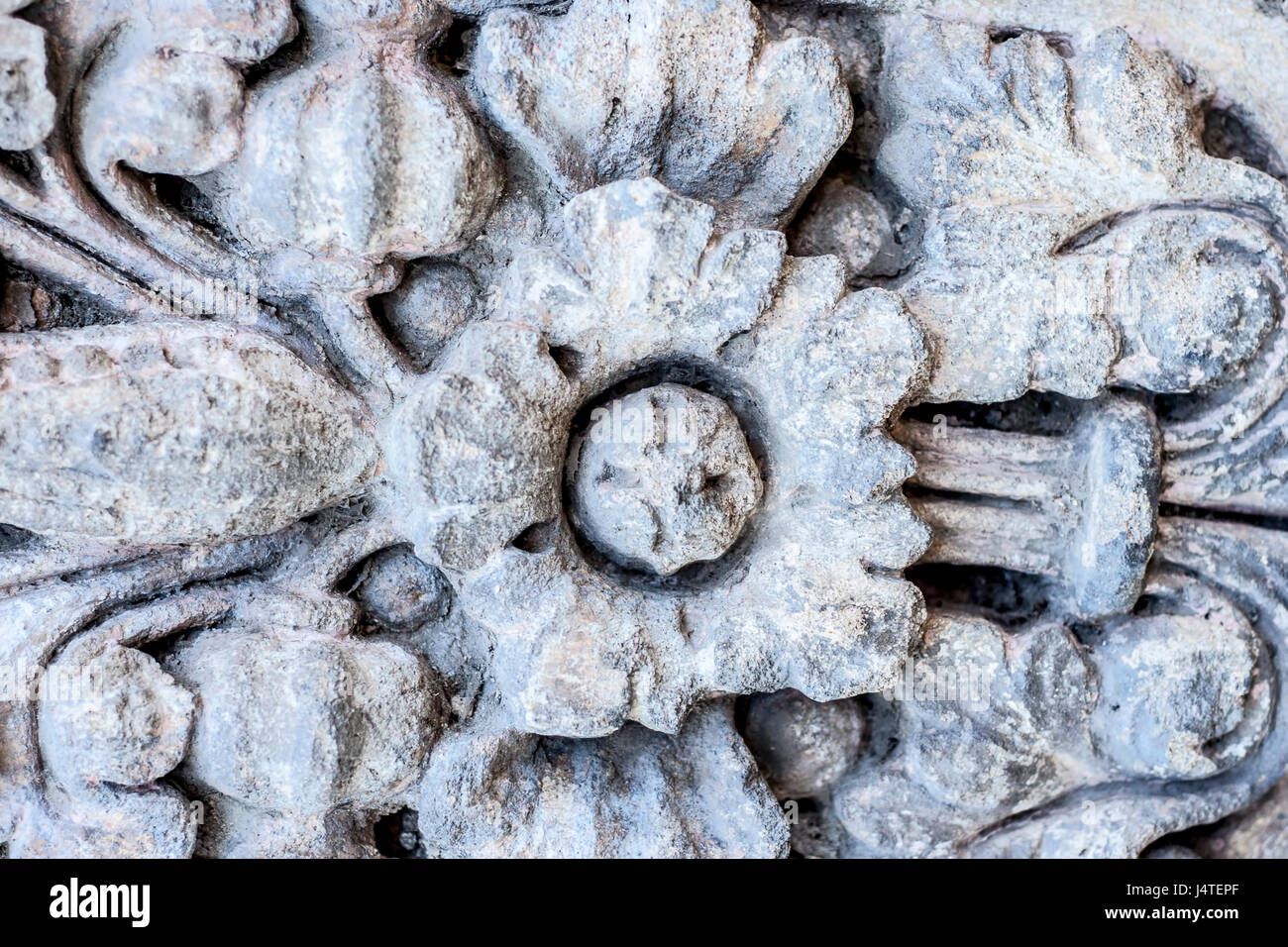 Vintage stone curving as background. - Stock Image