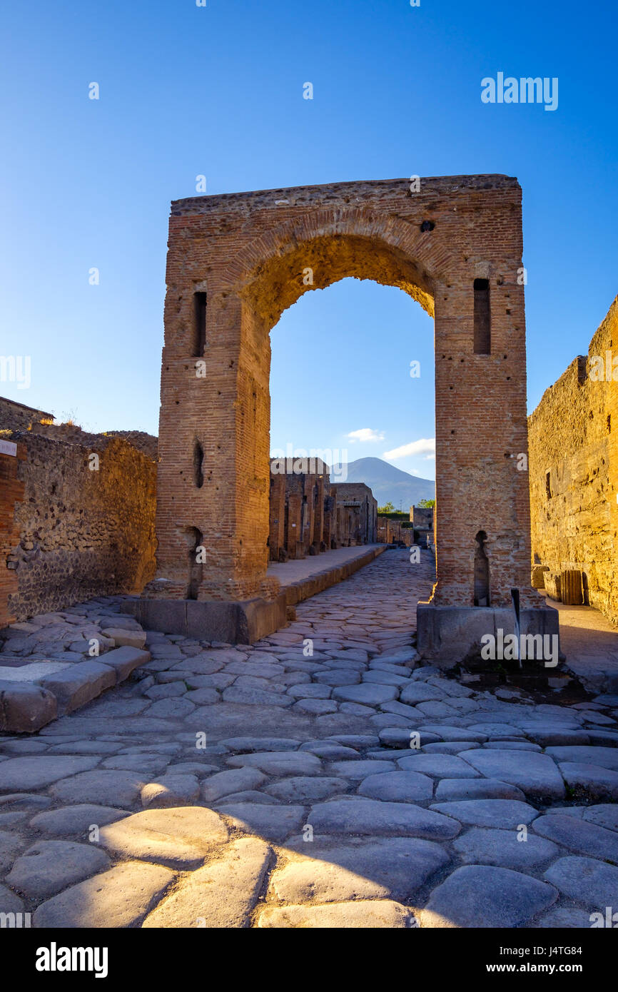 Scenic view of ruins at city of Pompeii with Vesuvio background, Italy - Stock Image