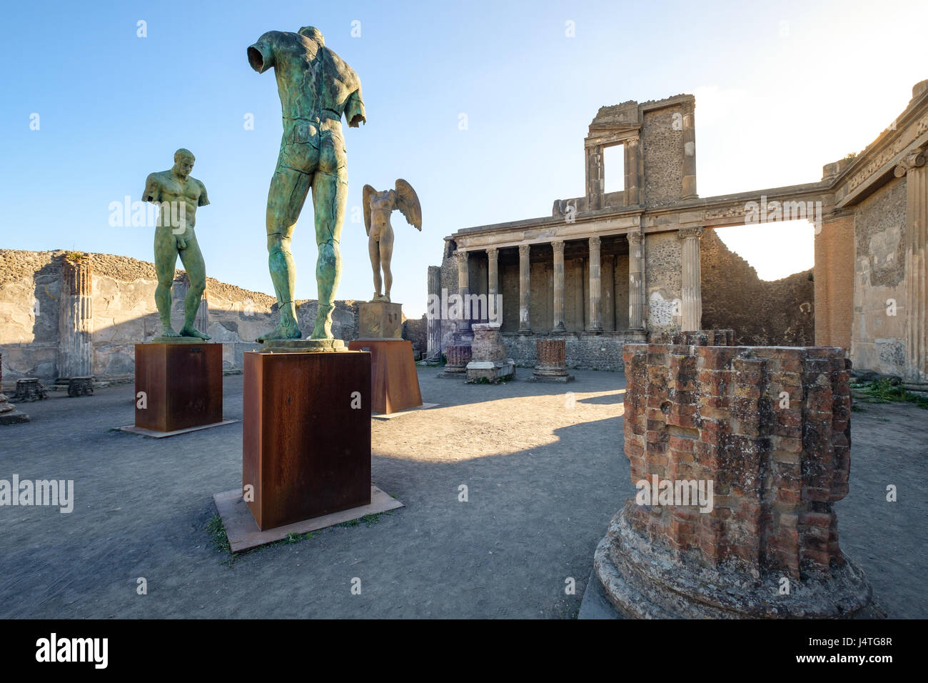 Scenic view of ruins and statues in ancient city of Pompeii, Italy - Stock Image