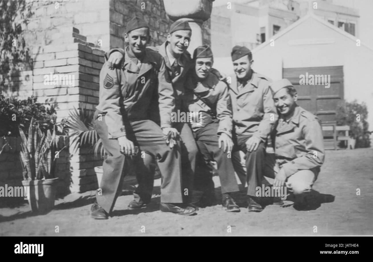 Five Serviceman Pose in foreign land, WW2 - Stock Image