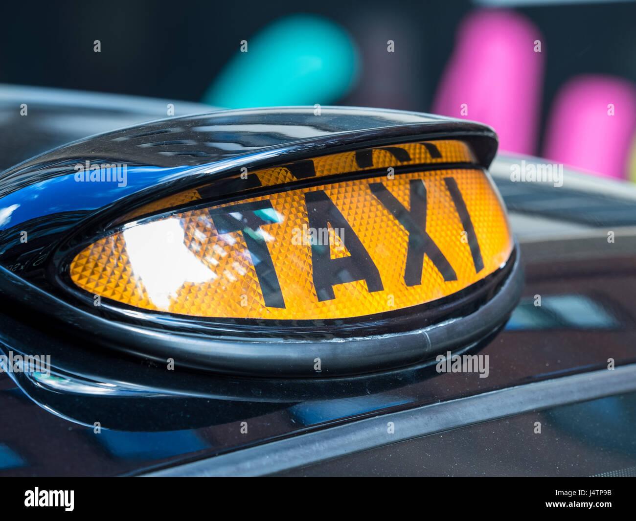 London Taxi Black Cab - Illuminated signs on the roof of London Taxis (Black Cabs) signal their availability for Stock Photo