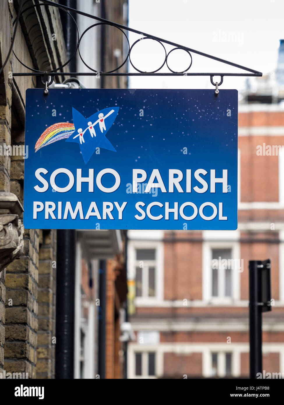 Sign outside the Soho Parish Primary School in London's central Soho district. The school is run by the Church - Stock Image