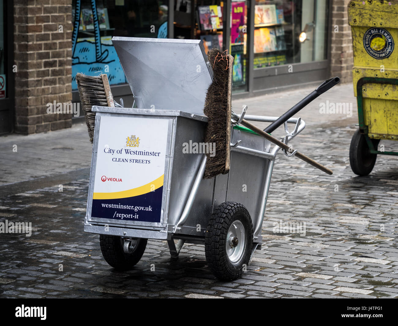 A street Cleaning cart belonging to Westminster council in central London Stock Photo