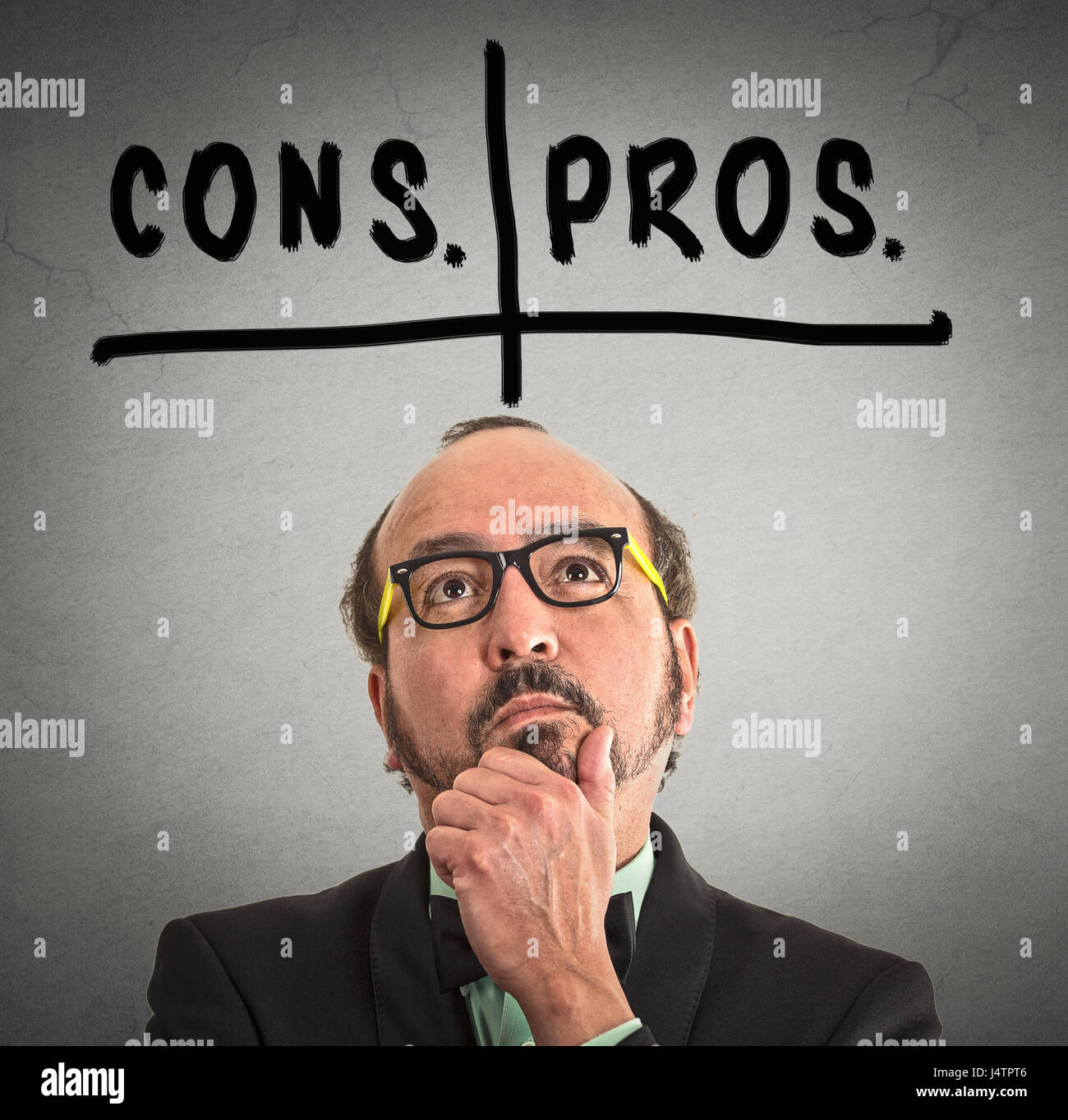 pros and cons, for and against argument concept. Thinking middle aged business man with glasses looking up isolated - Stock Image