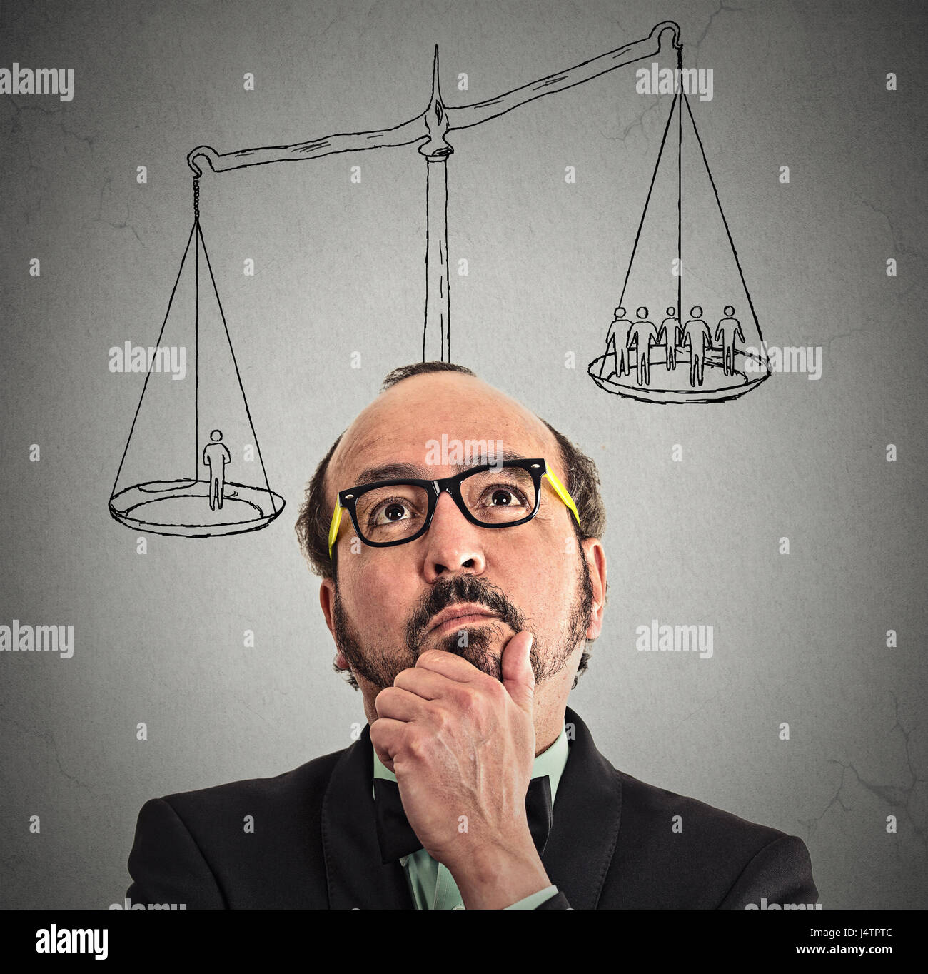 businessman with scale above head one man weighting more than group off business people on a balance. Power, opinion, - Stock Image