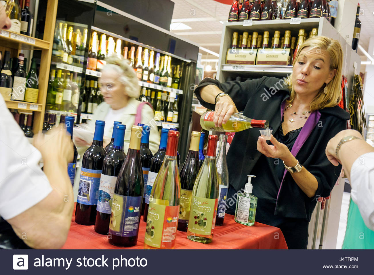 Palm Beach Florida Publix Grocery Store supermarket company business shopping groceries wine bottle free sample - Stock Image