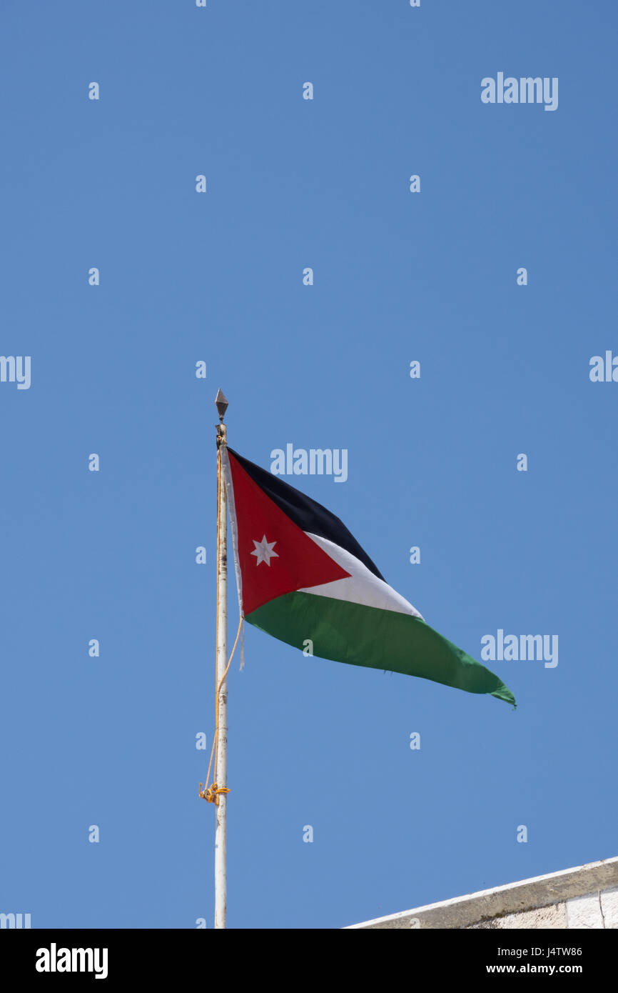 Jordanian flag with black, white, and green bands for the Abbasaid, Umayyad and Fatimid caliphates respectively Stock Photo