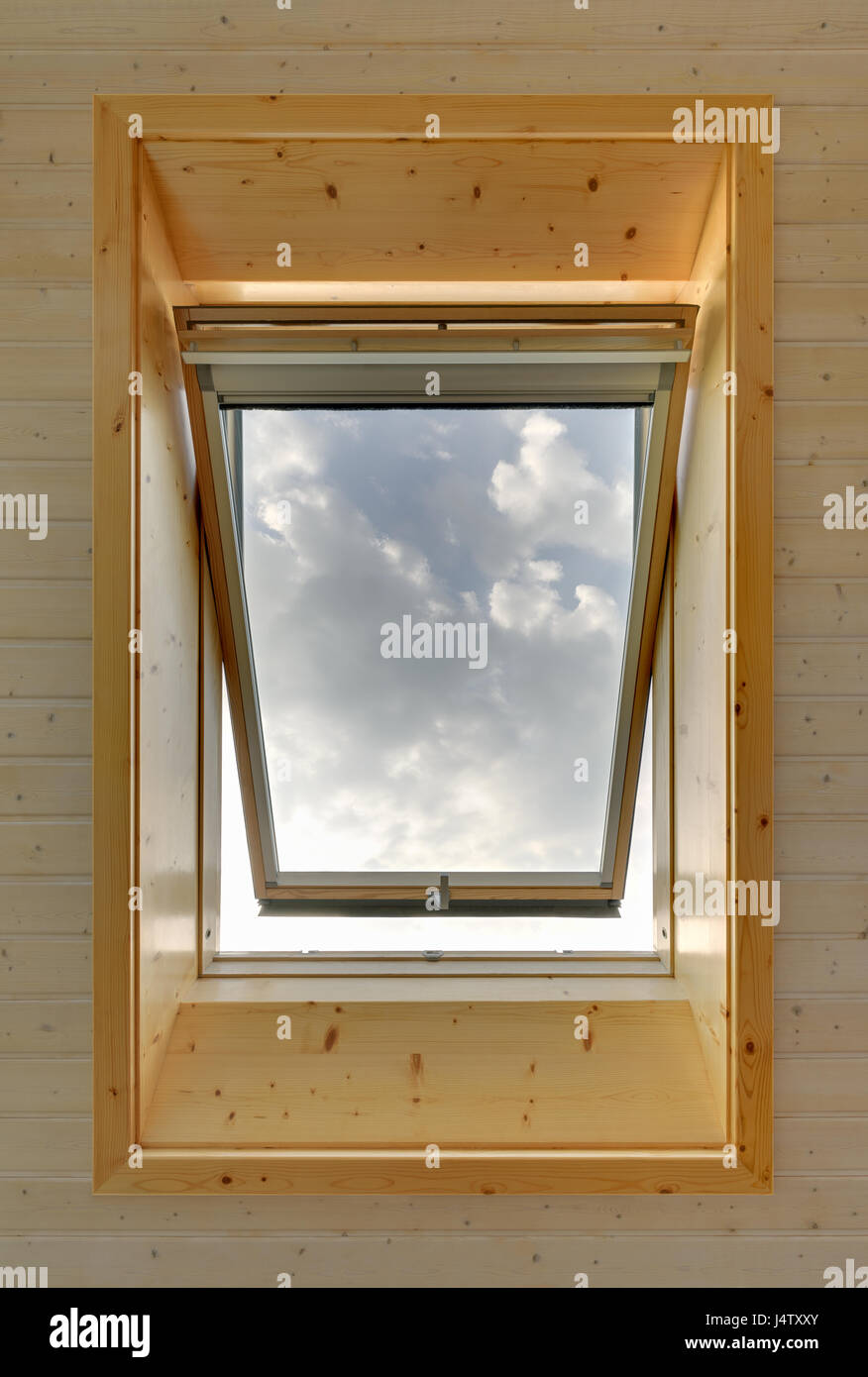 Opened roof top window wooden ceiling Stock Photo