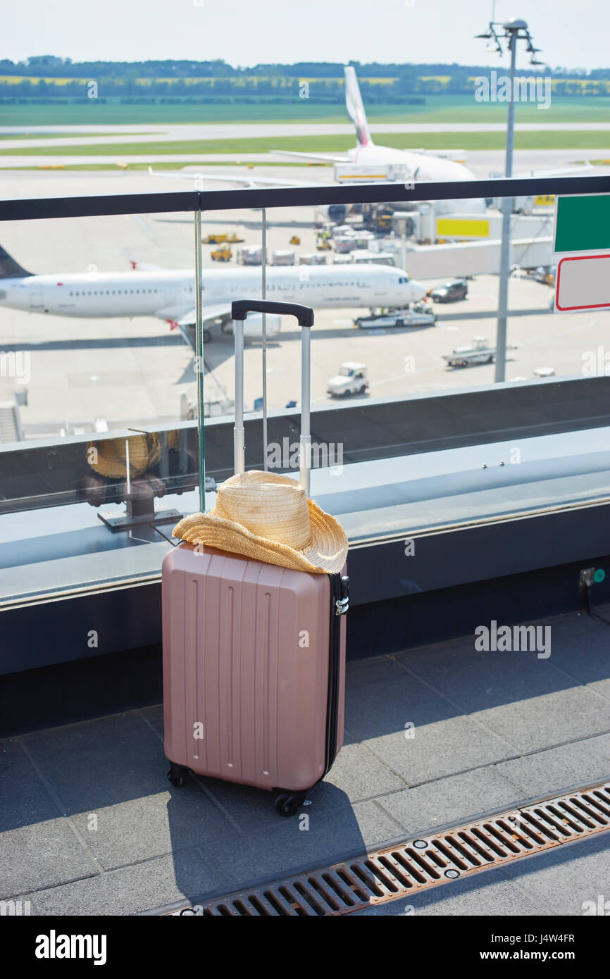 Suitcase in airport - Stock Image