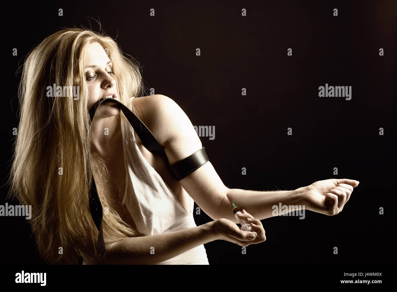 Young woman with drug addiction. Black and white photo - Stock Image