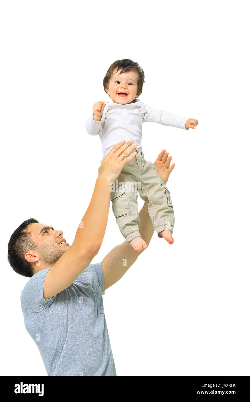 Joyful father giving piggyback ride to his son against a white b - Stock Image