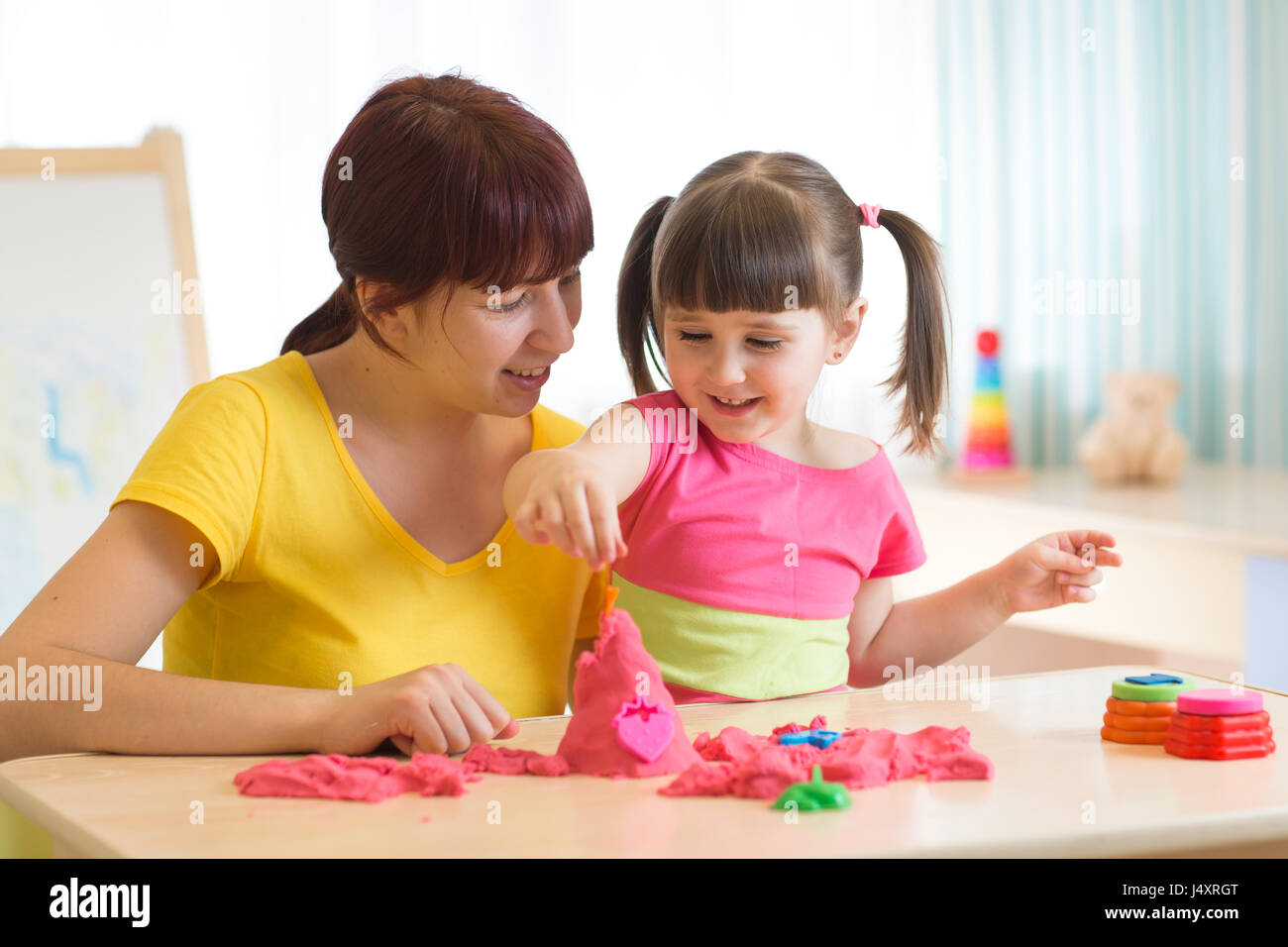 Child play with kinetic sand - Stock Image