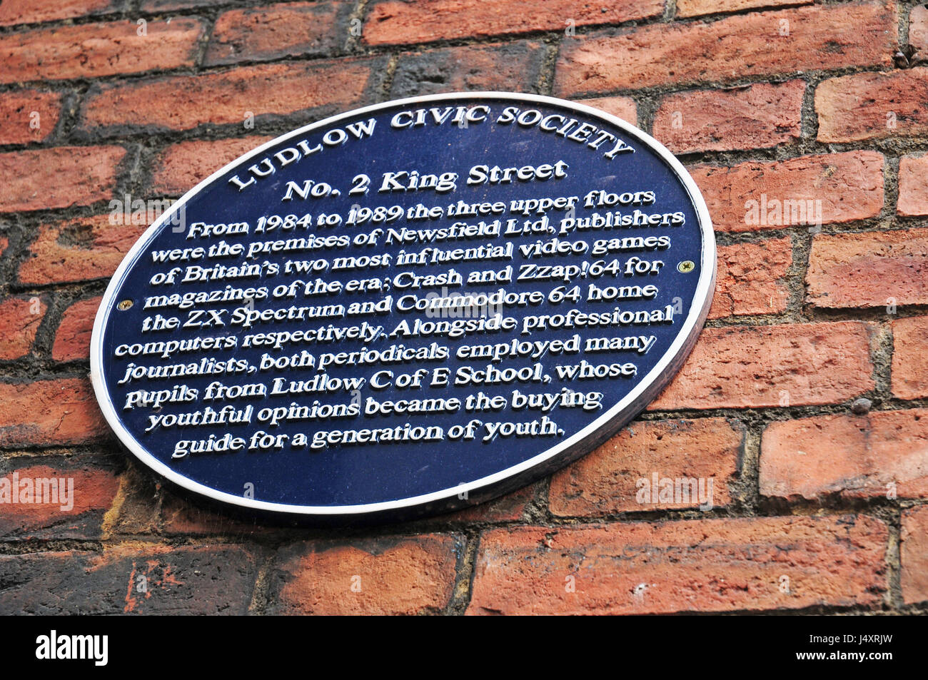 Round plaque commemorating Newsfield Ltd., Publishers of Crash and Zzap!64.  Ludlow. - Stock Image