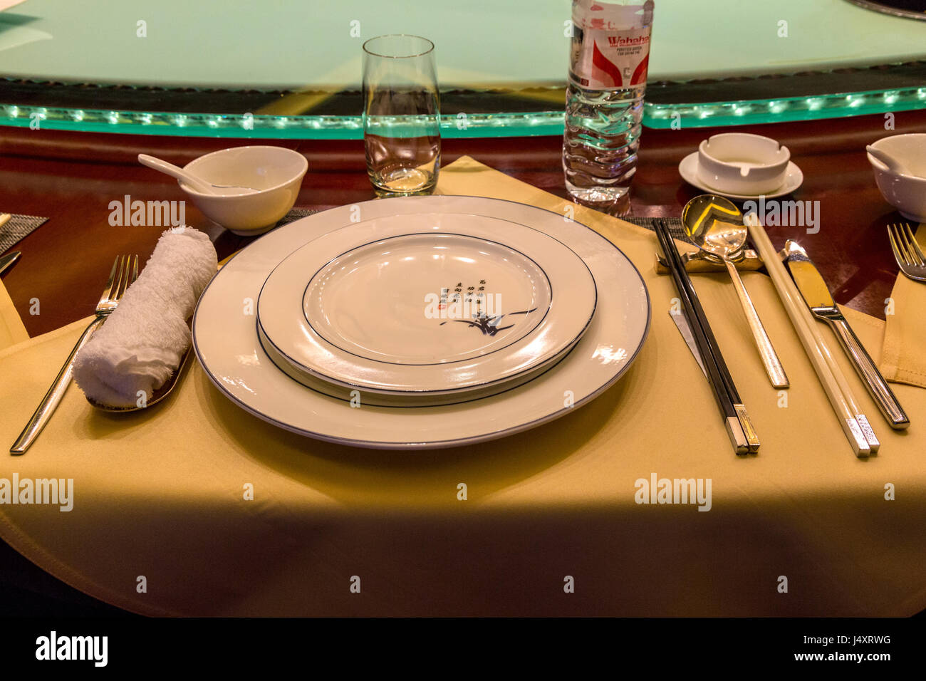 Chinese Table Place Setting with Chopsticks. Lazy Susan (Rotating Serving Table) in background. & China. Chinese Table Place Setting with Chopsticks. Lazy Susan Stock ...
