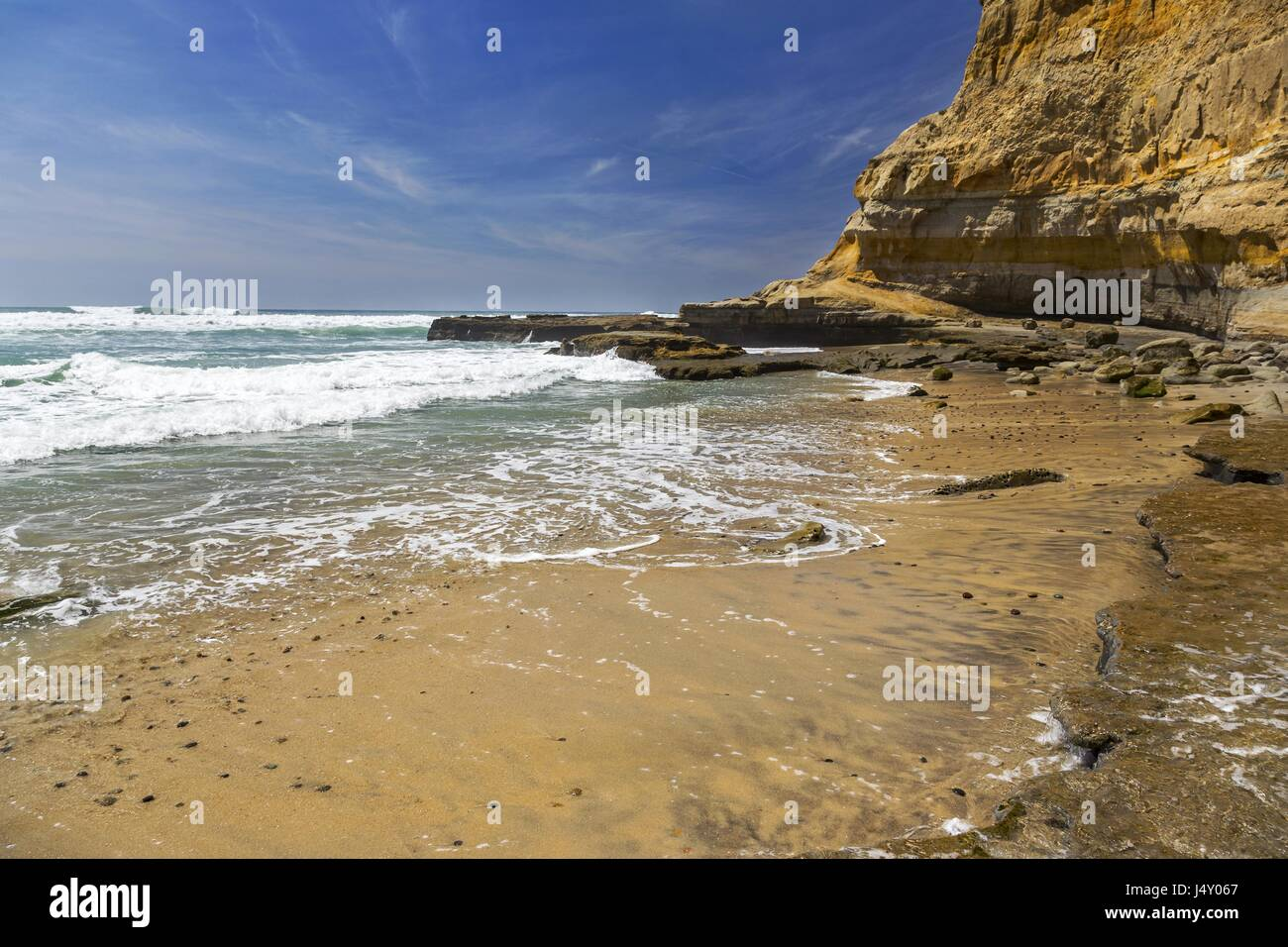 Flat Rock on Torrey Pines State Beach north of San Diego, California - Stock Image