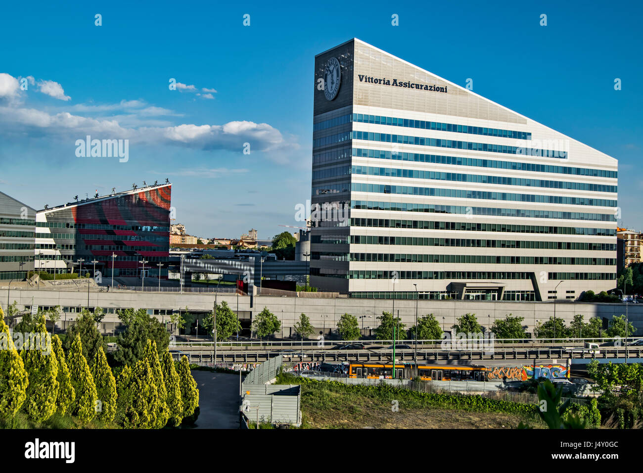 a modern trapezoidal building viewed from portello park in milan city - Stock Image