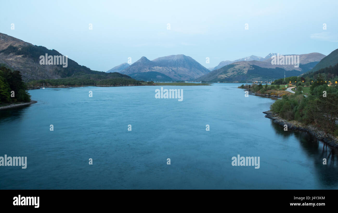 The Pap of Glencoe and other mountains surround Loch Leven sea loch at Ballachulish in the West Highlands of Scotland. - Stock Image