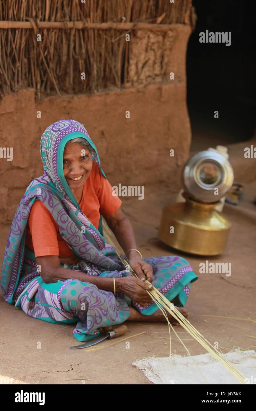 Woman making cane items. Kawant, Gujarat, India - Stock Image