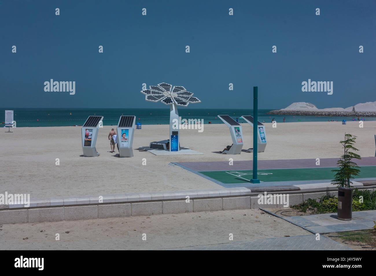 SOLAR ON THE BEACH,DUBAI, UAE-16TH AUG 2015:-The Beach is high tech with solar panels on the charging stations Stock Photo
