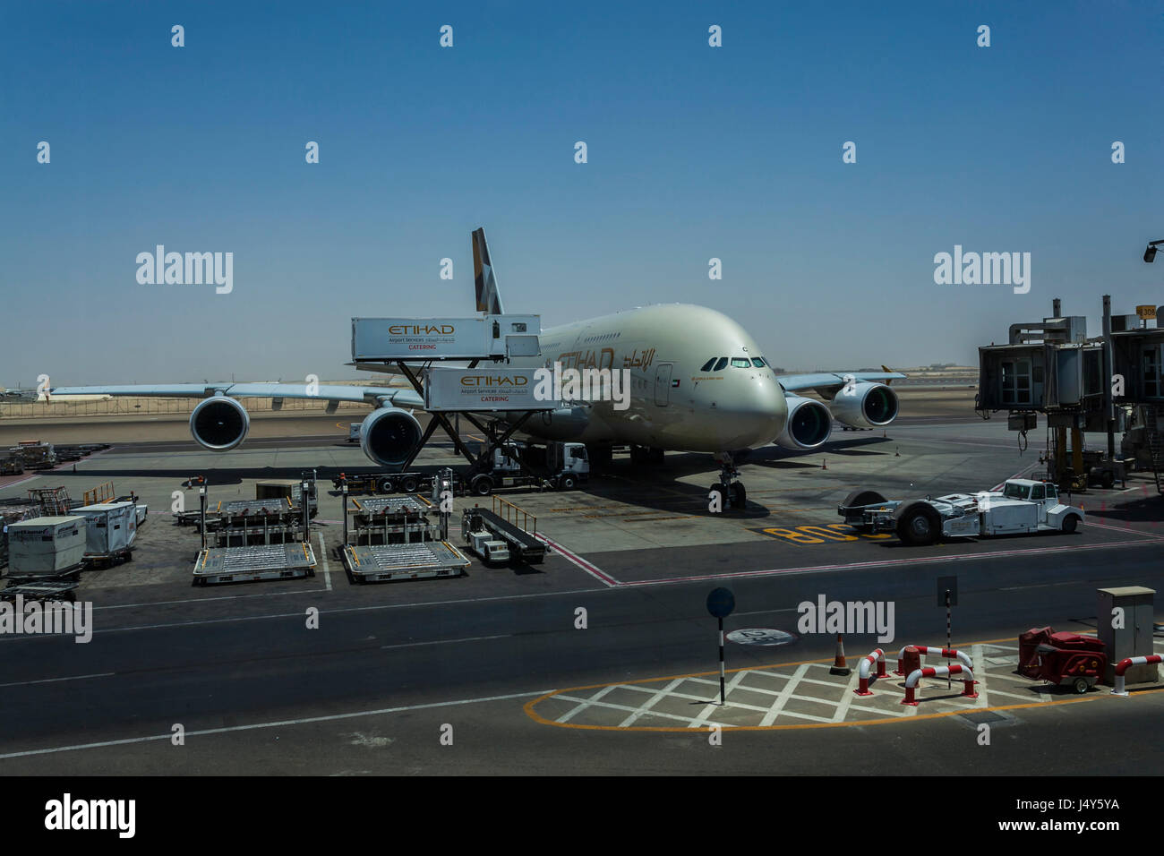 ABU DHABI AIRPORT, ABU DHABI, UAE-17TH AUG 2015:-Airplane being loaded for the flight to Australia Stock Photo