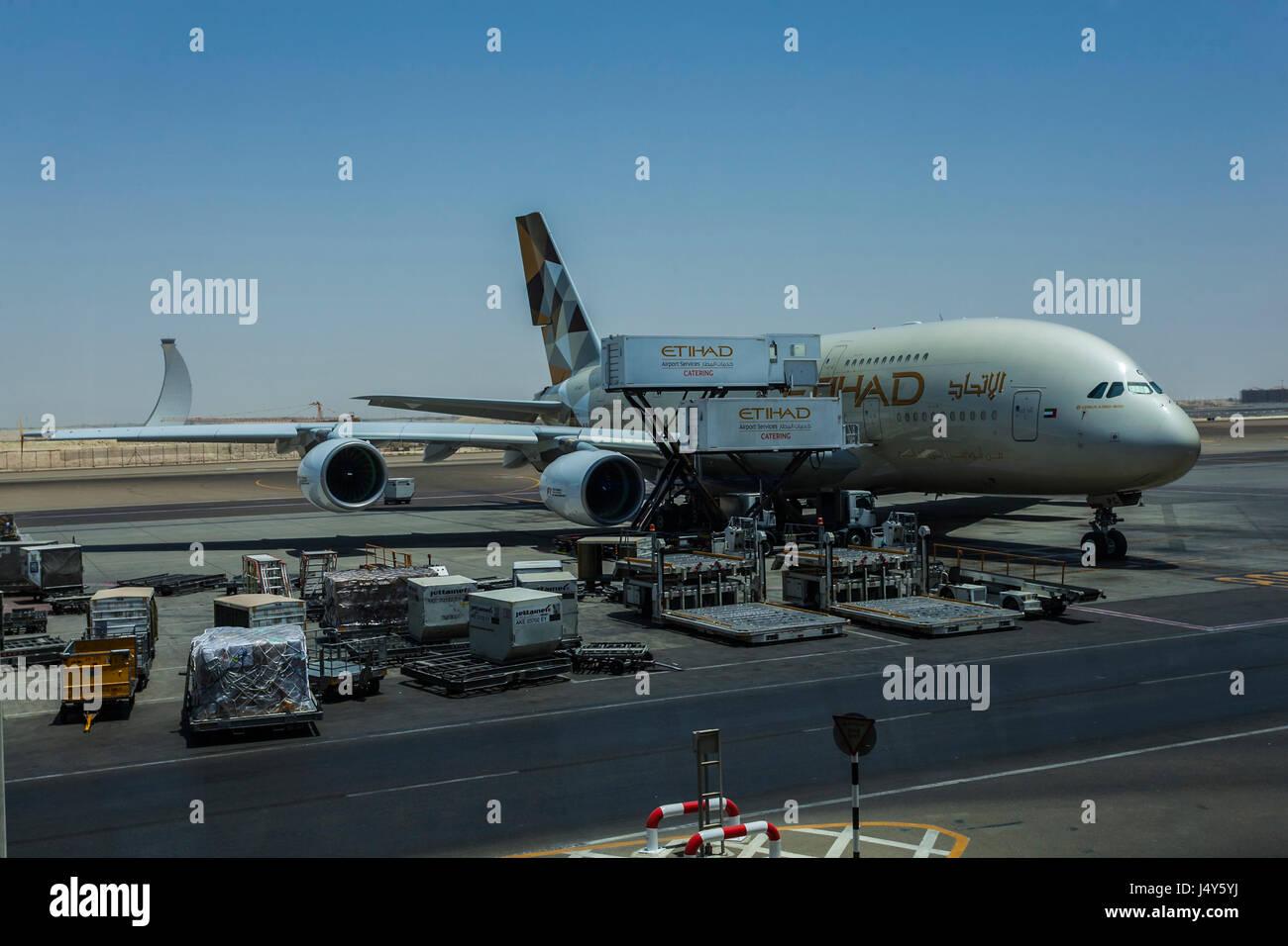 ABU DHABI AIRPORT, ABU DHABI, UAE-17TH AUG 2015:-Airplane being loaded for the flight to Australia Stock Photo