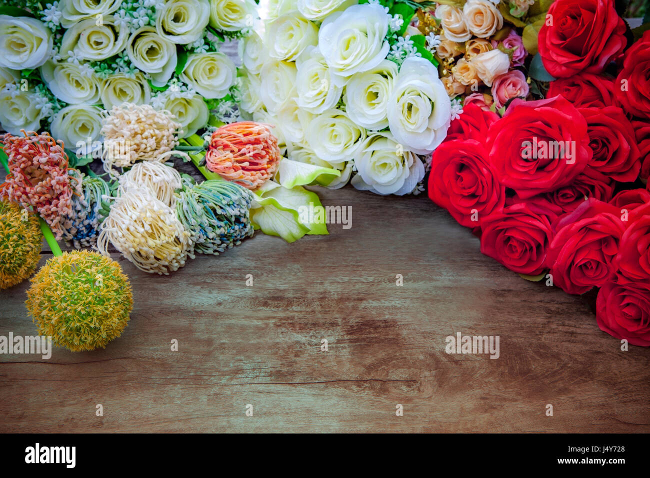 White red roses and flowers bouquet decor on top of wood table with white red roses and flowers bouquet decor on top of wood table with free space background izmirmasajfo