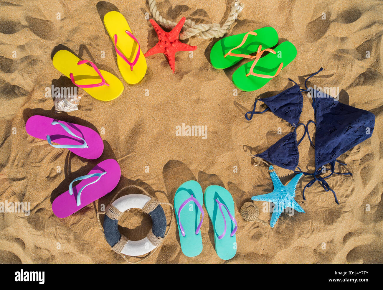 Summer beach fun - frame on sand with colorful sandals and swimming ...