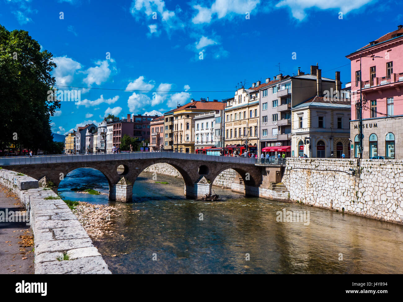 Sarajevo, Bosnia and Herzegovina - 12 September 2014 - Sarajevo and river Miljacka on a sunny day, with people and - Stock Image