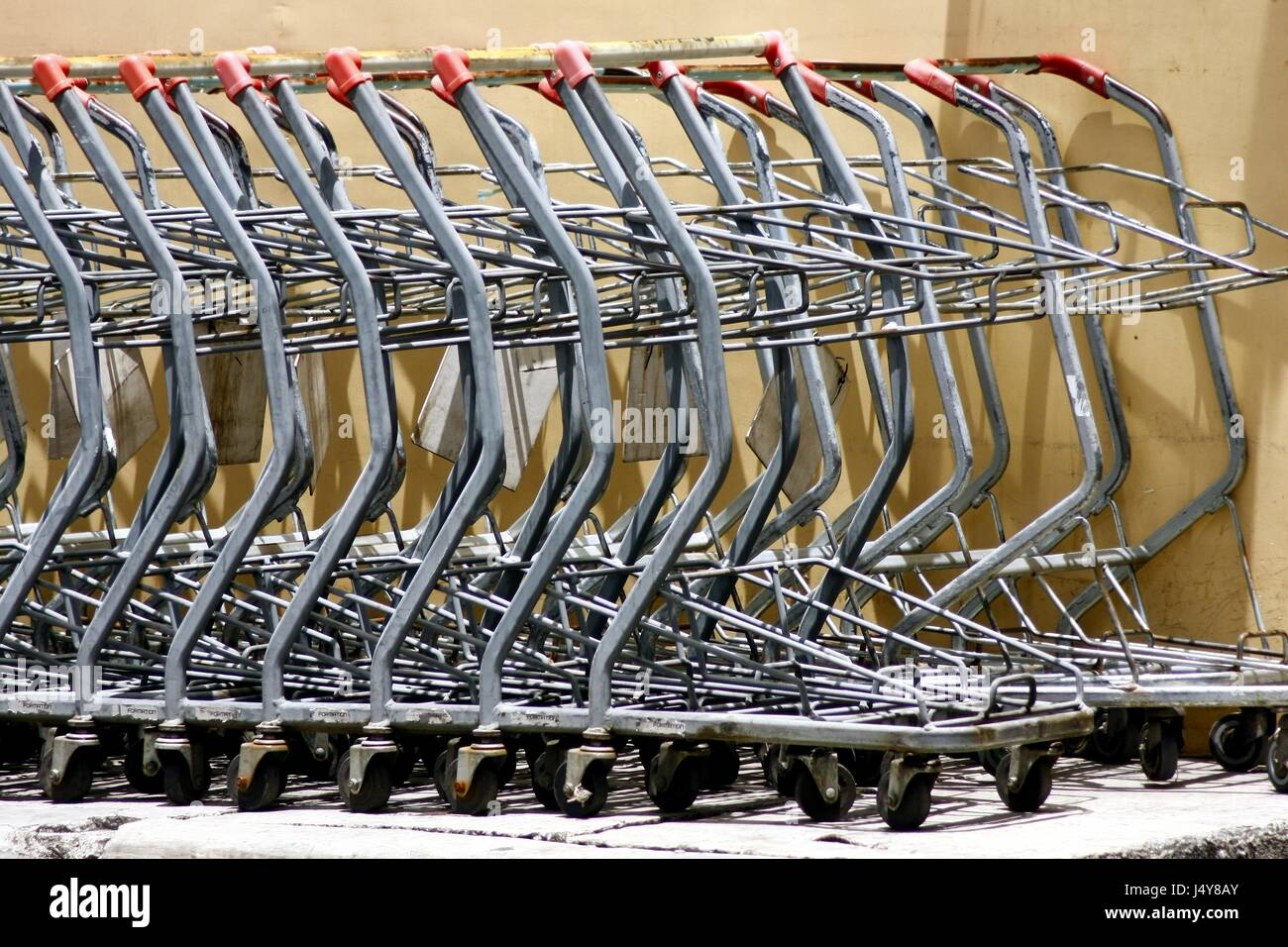 Photo of stacked old grocery or shopping carts - Stock Image