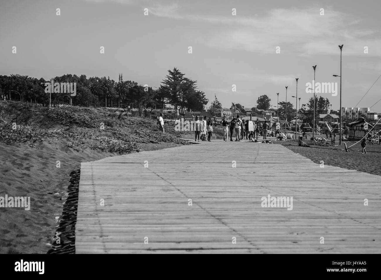 Flat view of a wooden pathway at the beach - Stock Image
