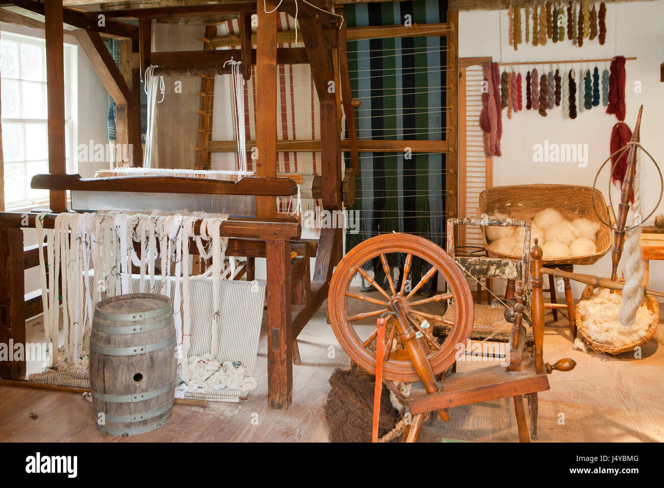 Depiction of a weaver's cottage in the 18th century colonial America - USA - Stock Image