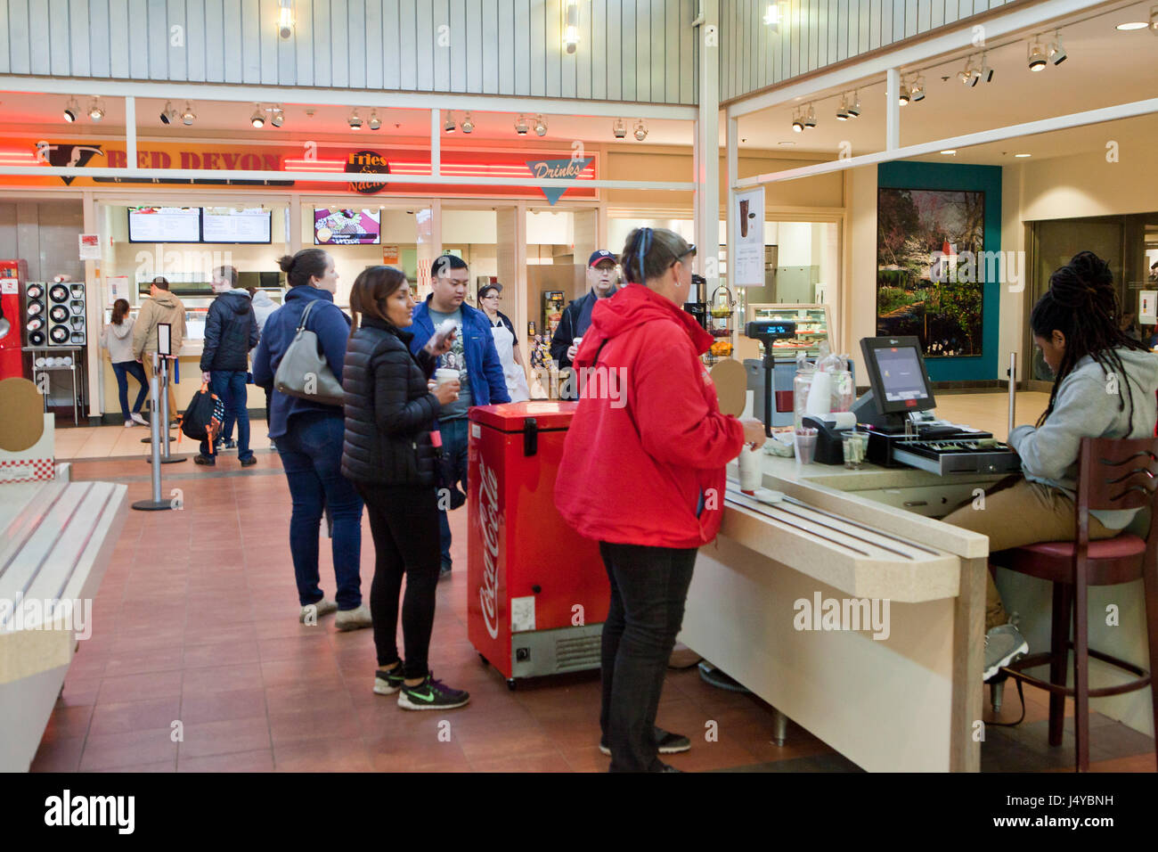 Food court checkout in a building - USA - Stock Image