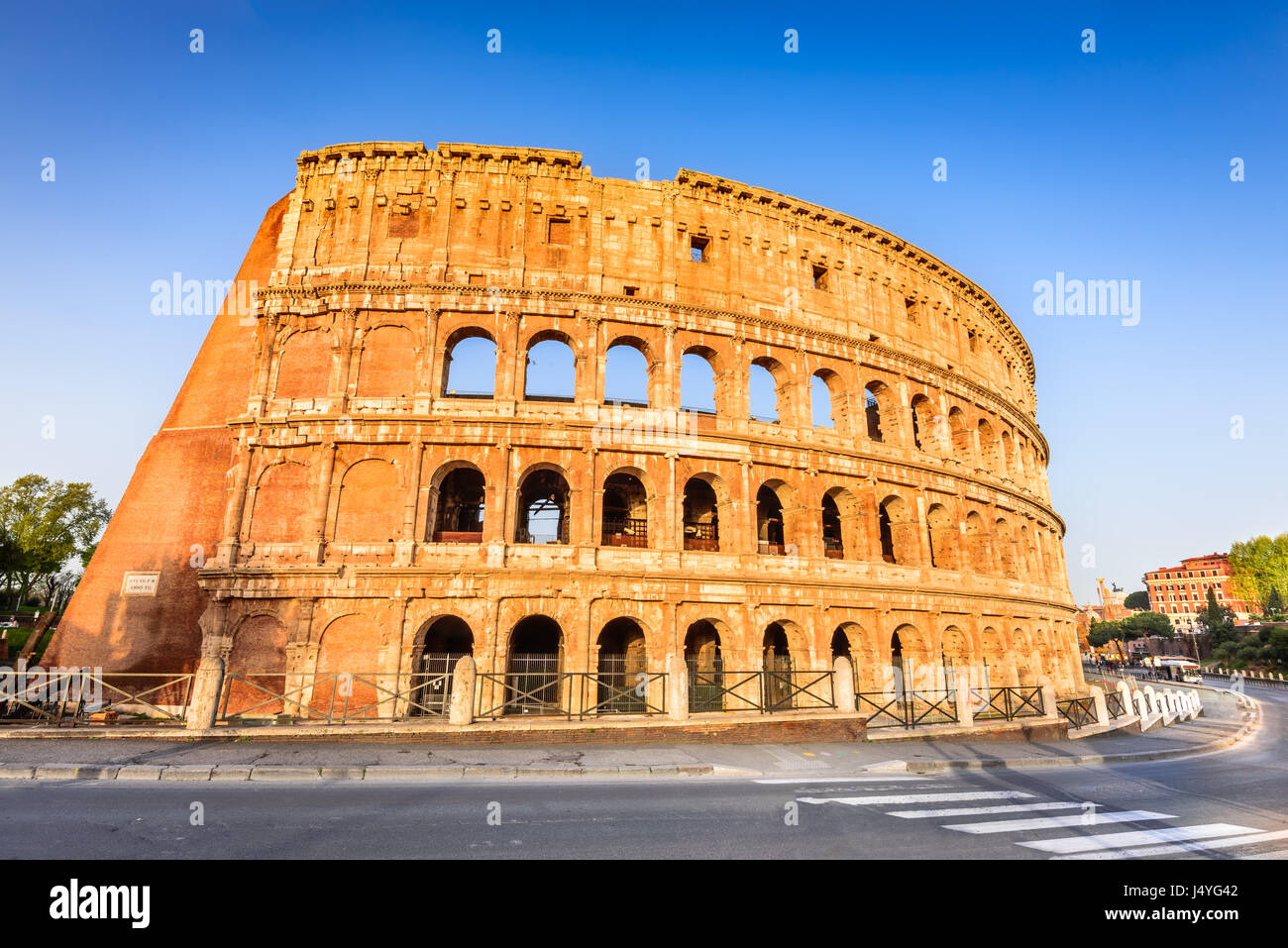 Rome, Italy. Colosseum in Roma, Italia. Symbol of the ancient city. Amphitheatre in sunrise light. - Stock Image