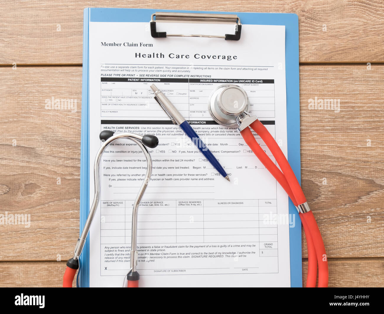Health care insurance claim form with pen and stethoscope - Stock Image