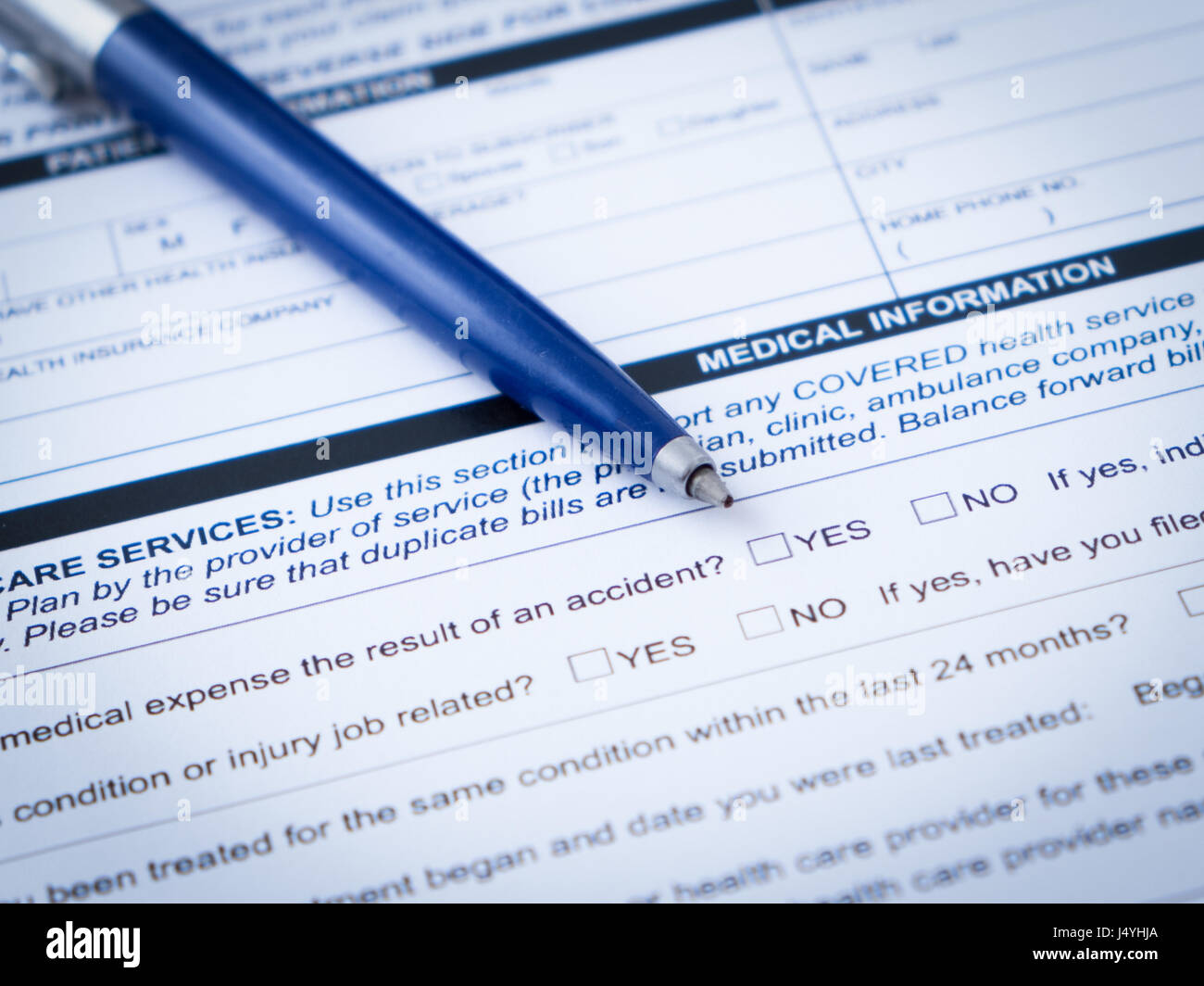 Health care insurance claim form with pen - Stock Image
