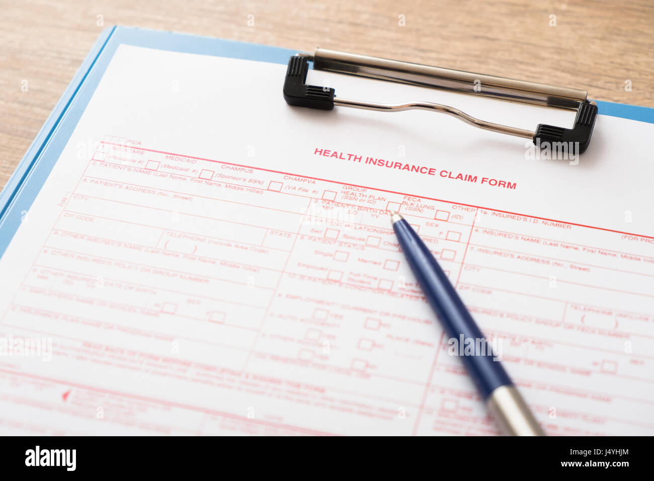 Health insurance claim form with pen - Stock Image