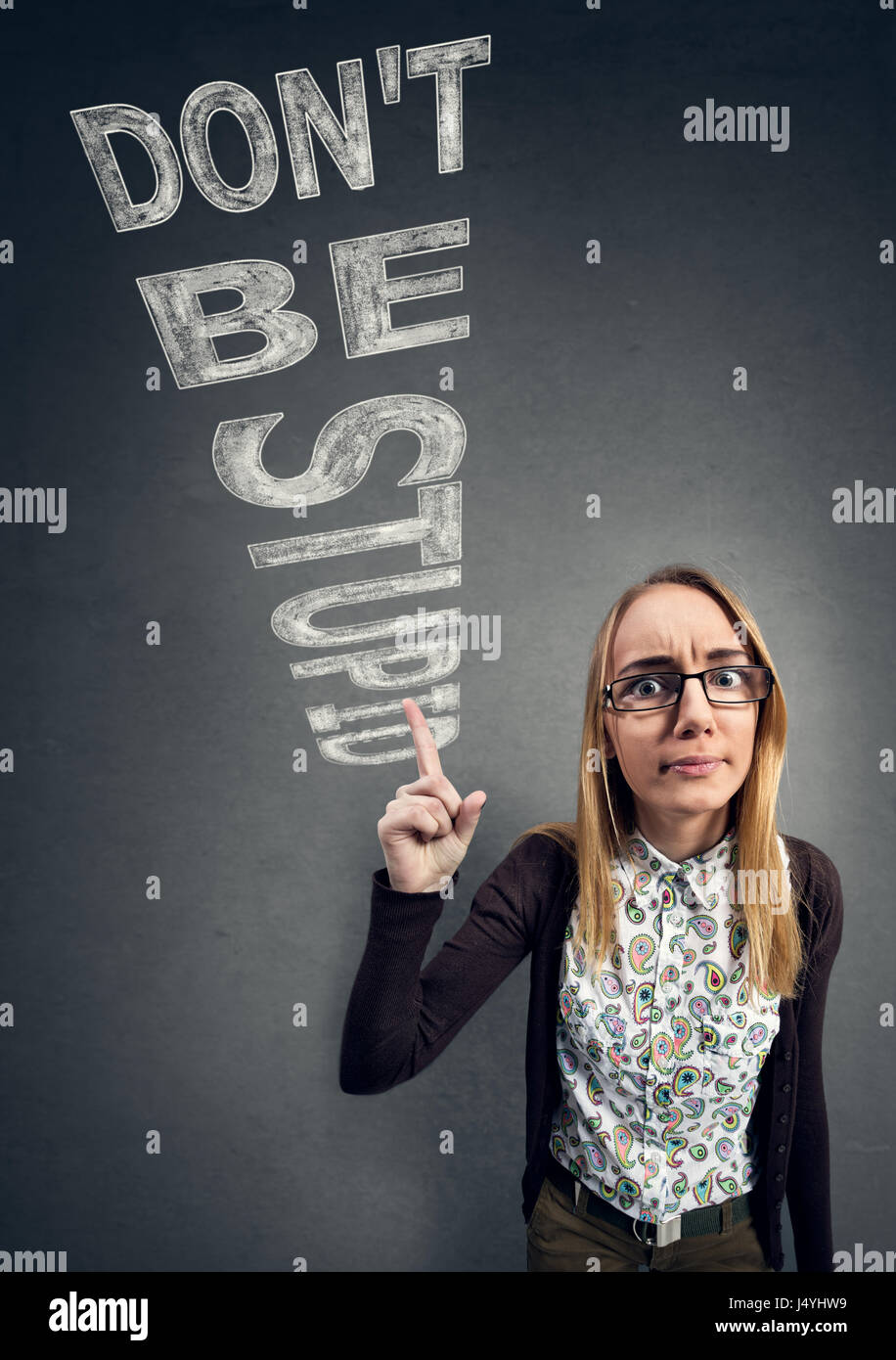 Schoolgirl nerd confronts ignorance with words don't be stupid - Stock Image