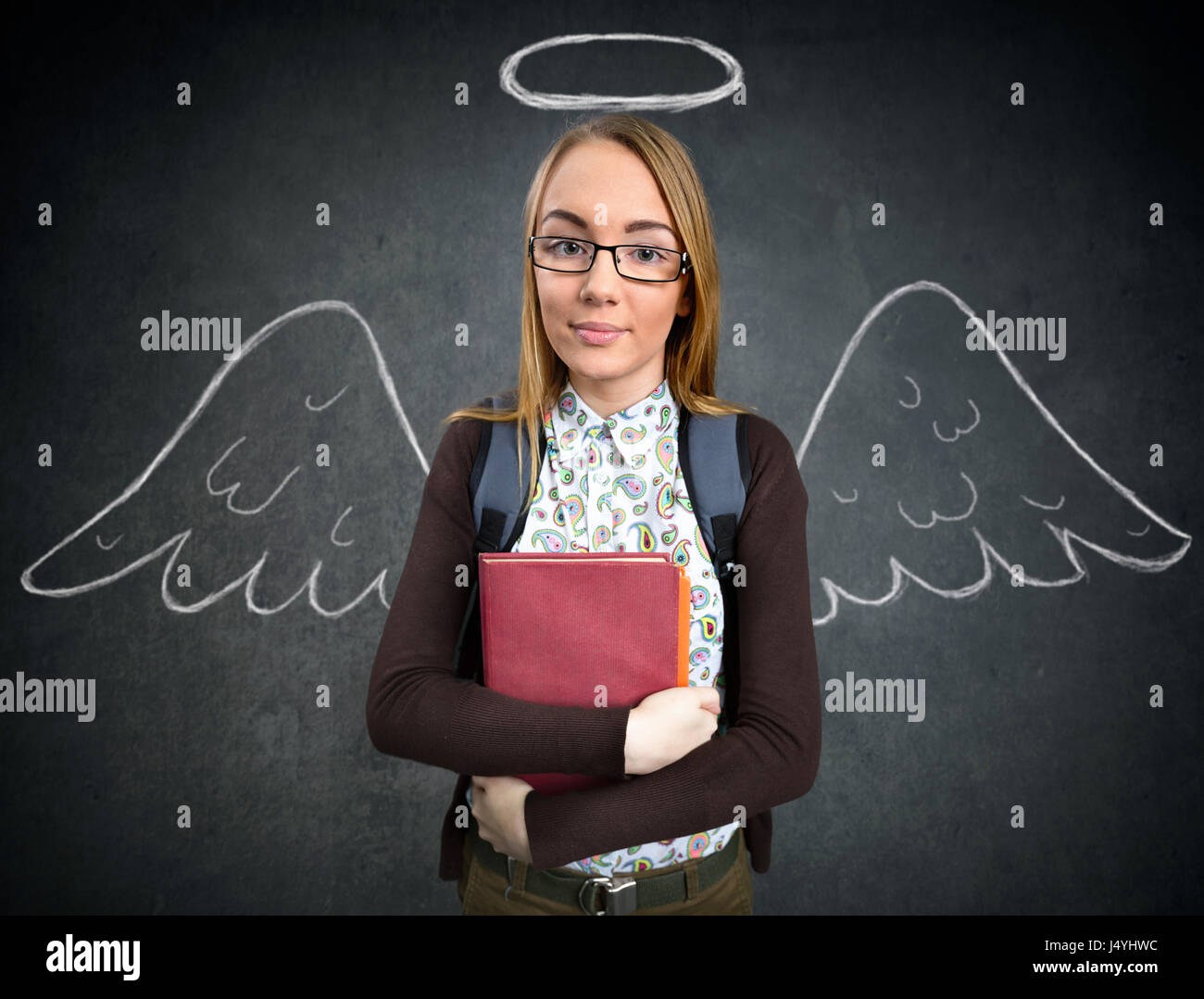schoolgirl with funny angel wings and nimbus - Stock Image