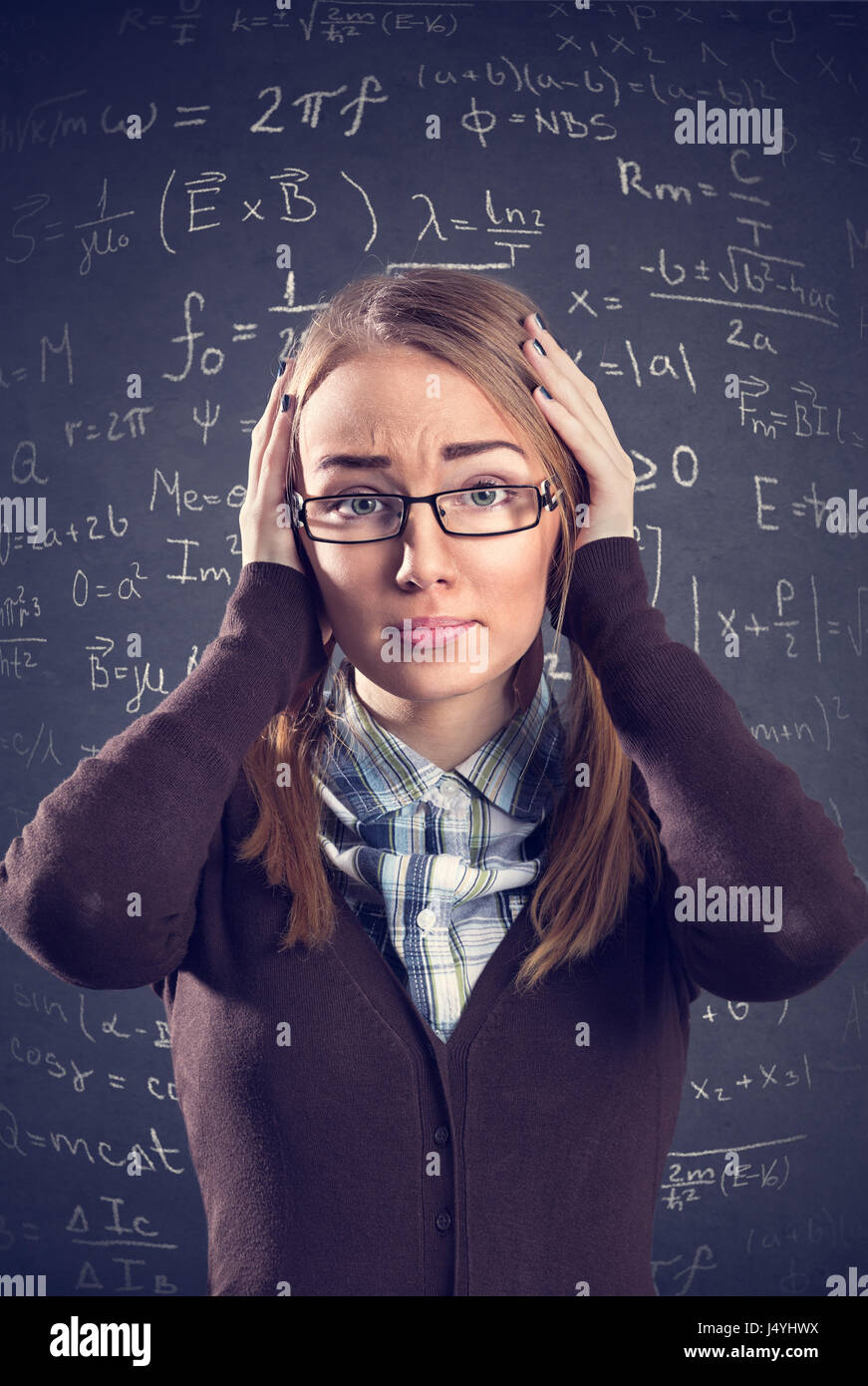 desperate female student confused with math formulas stock photo