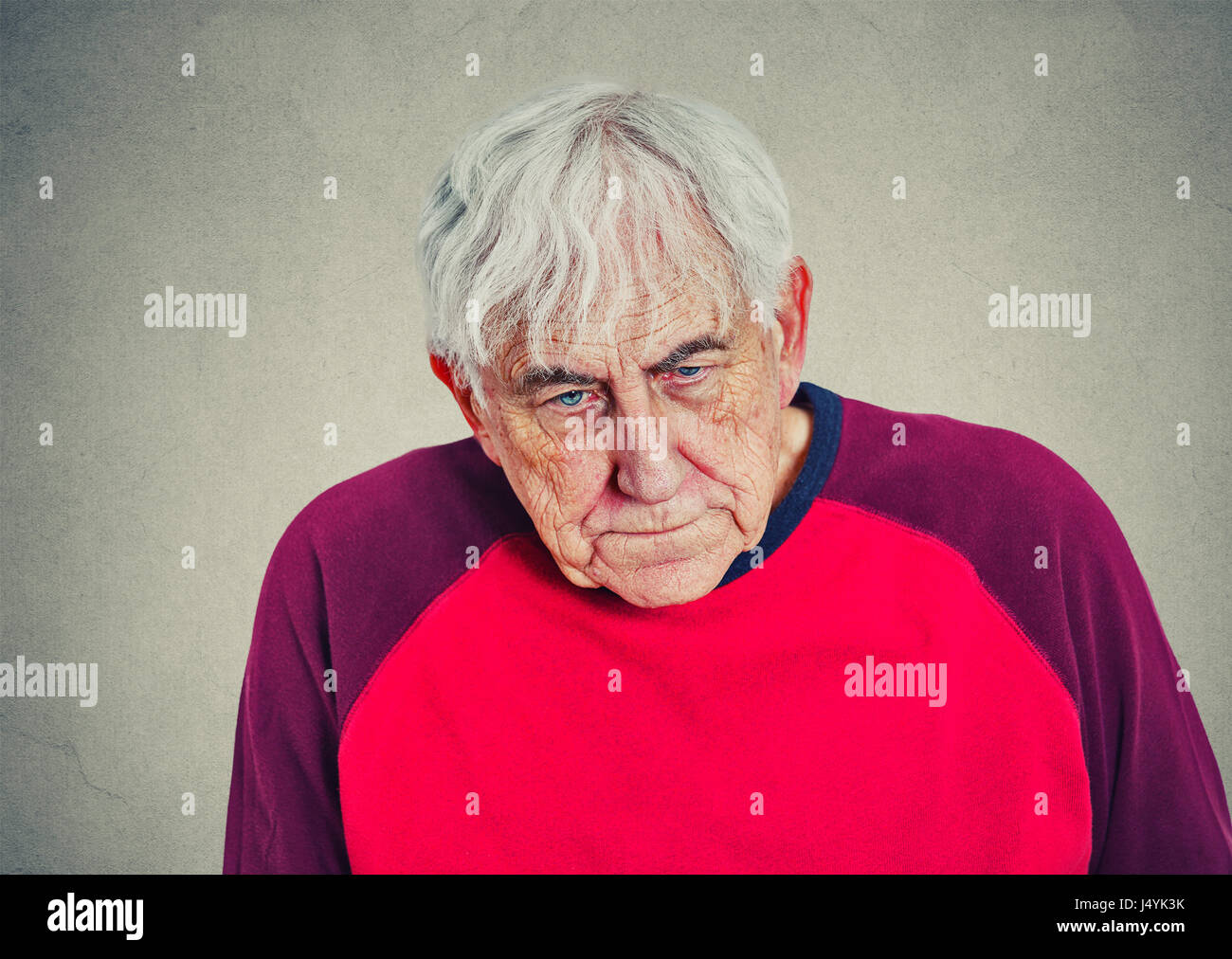 Portrait of an elderly depressed man - Stock Image