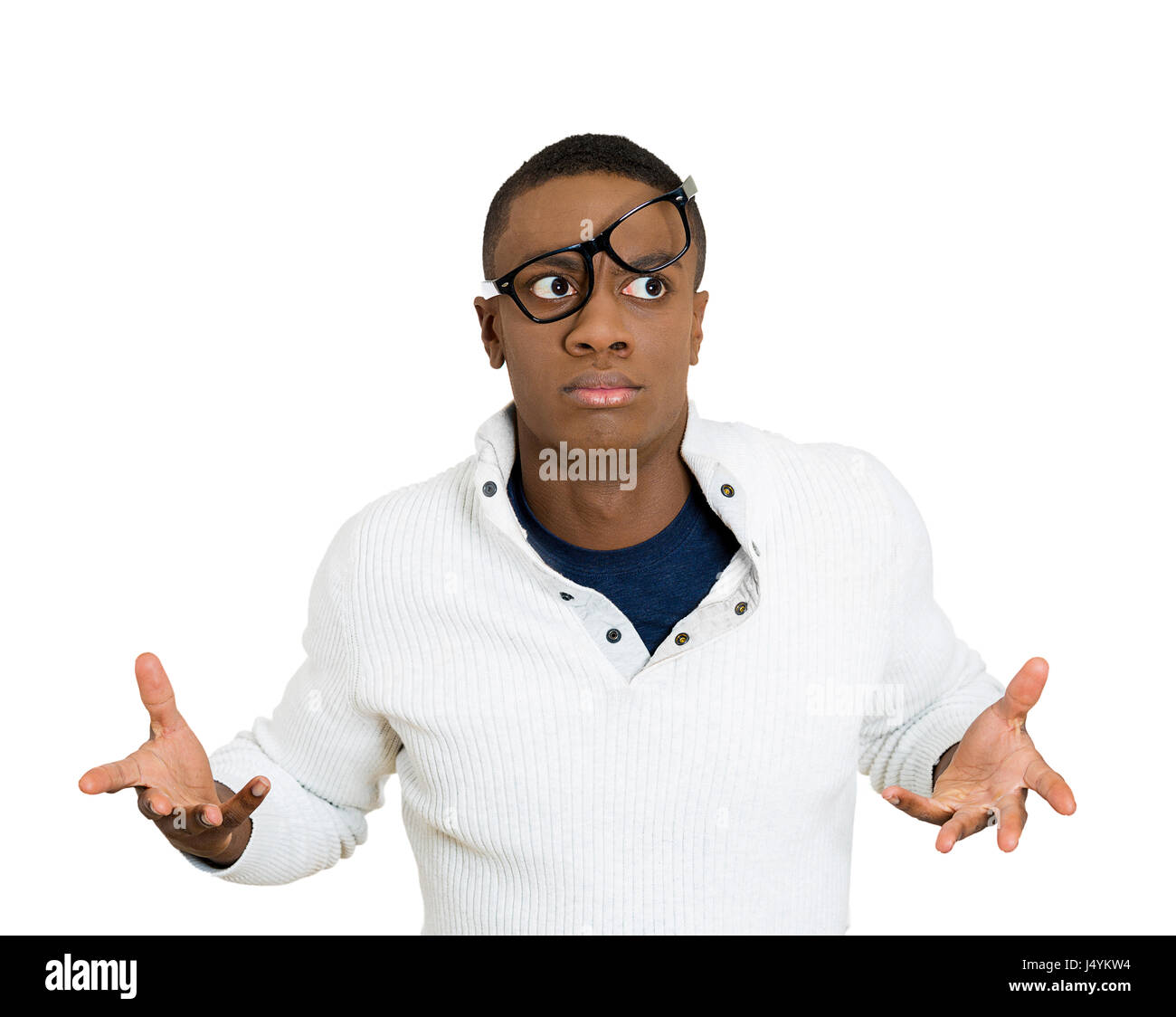 Closeup portrait, dazed, nerd young man with big glasses messed on face, open mouth, embarrassed, failed excuse - Stock Image