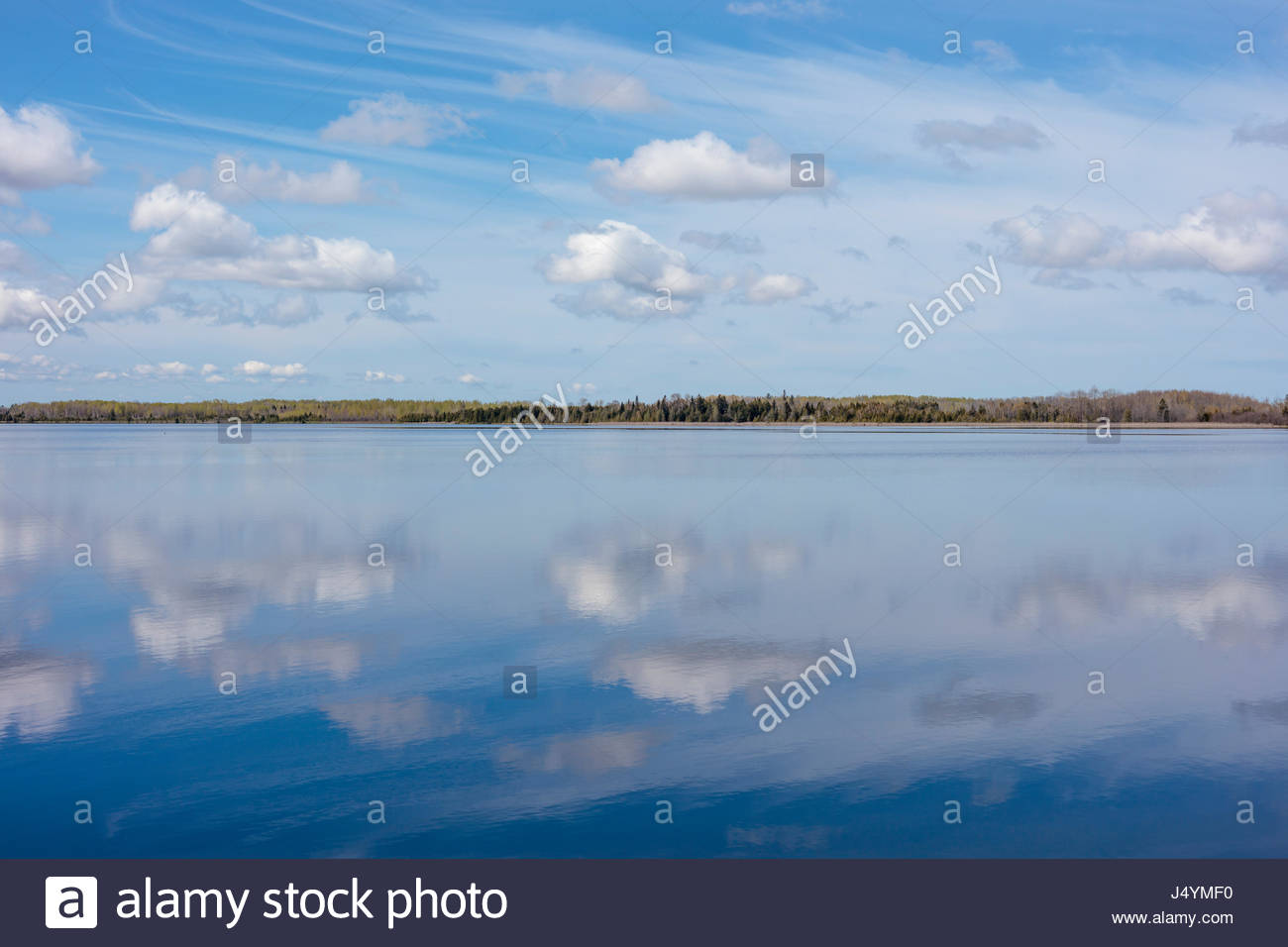 Variable cloudiness clouds reflected in Canal Lake one of the Kawartha Lakes on the Trent Severn Waterway in Ontario, - Stock Image