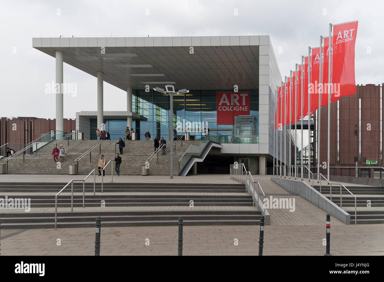 The entrance  to Art Cologne with people at the stairs. The  modern building of the fair is part of koelnmesse. - Stock Image
