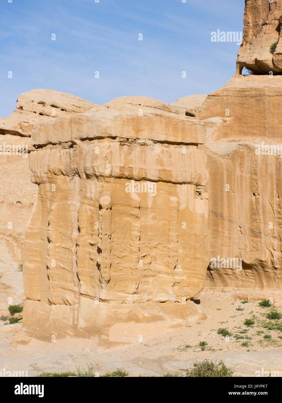 Hand carved stone Djinn blocks marking the entrance to tombs in Petra Jordan, the ancient Nabataean city of Raqmu. Stock Photo