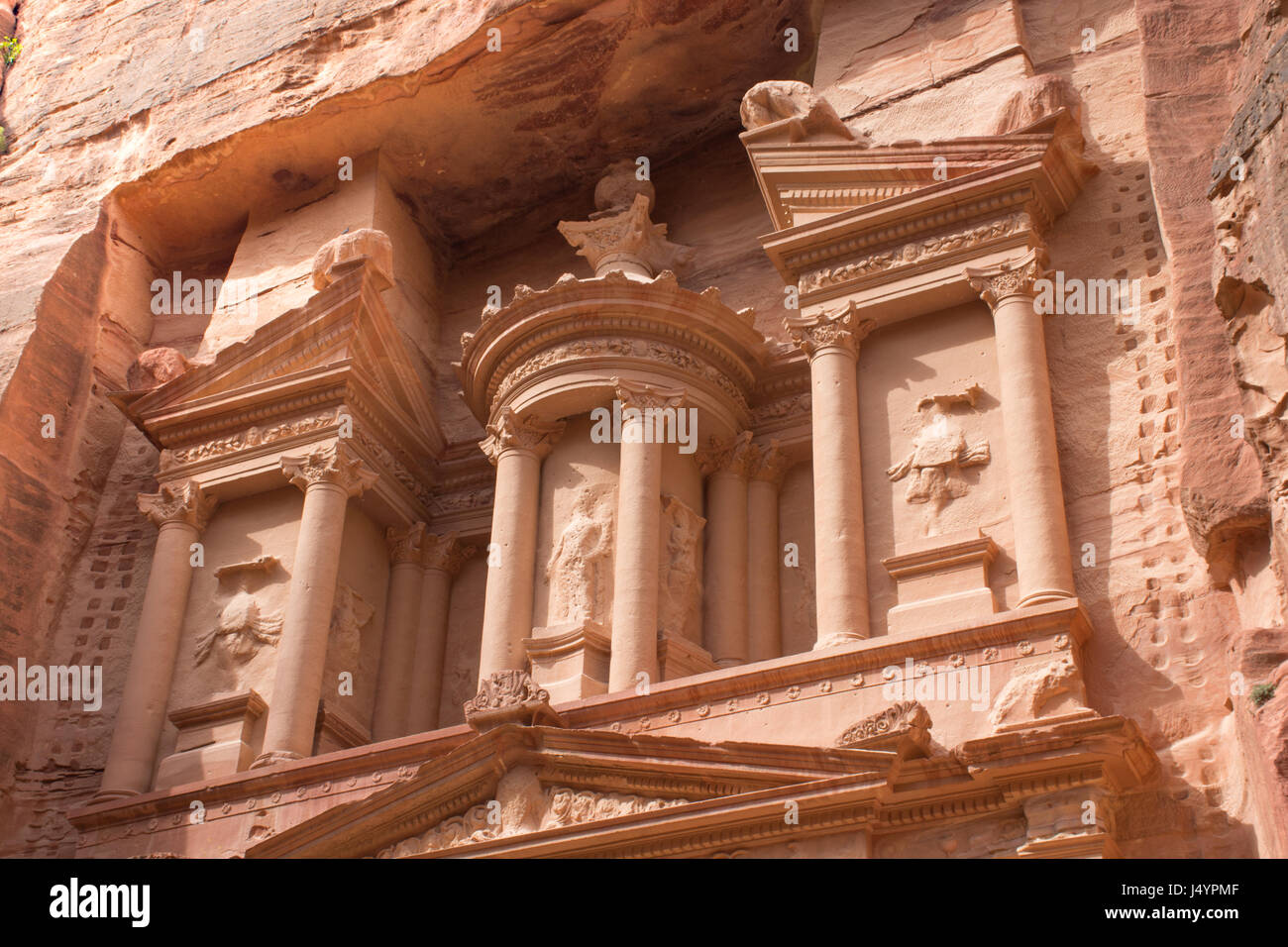 Close up of the Treasury, an ancient building in Petra, Jordan. Orange stone with columns carved by Nabataens is Stock Photo