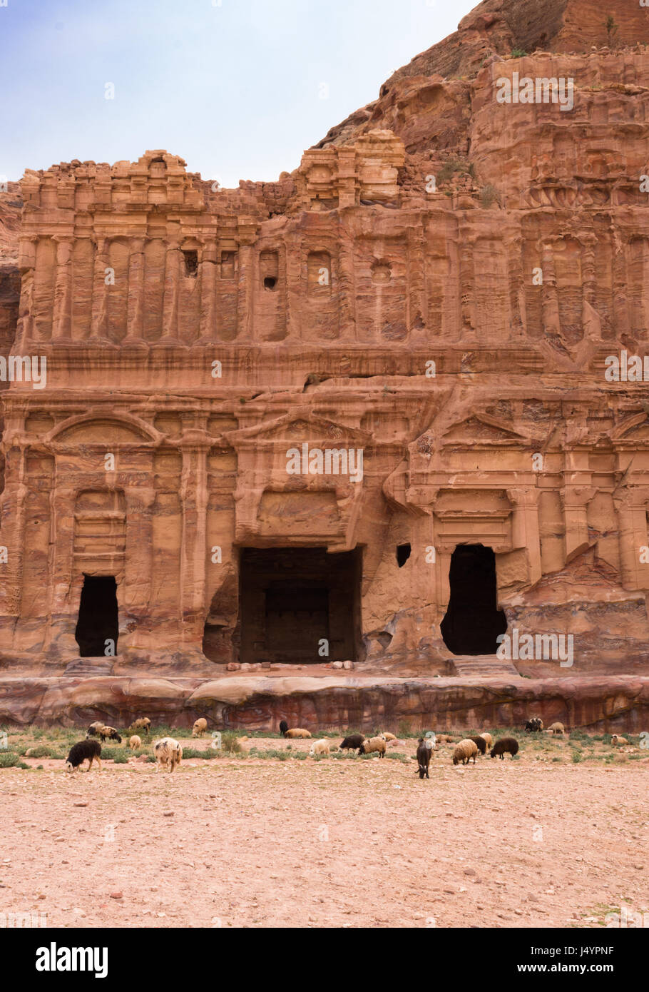 The ornately carved sandstone facade surrounding the entrance of the Corinthian Tomb in Petra or Raqmu, Jordan. Stock Photo